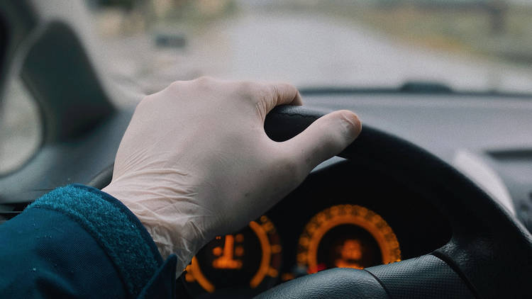 Gloved hand driving