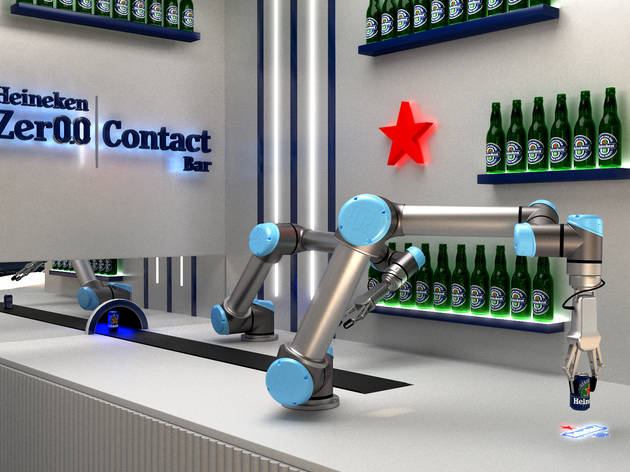 Robots holding beer in front of wall