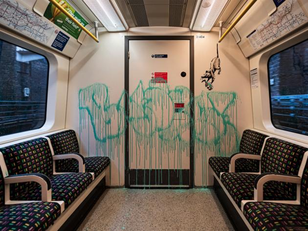 Banksy face-mask street art on London Underground