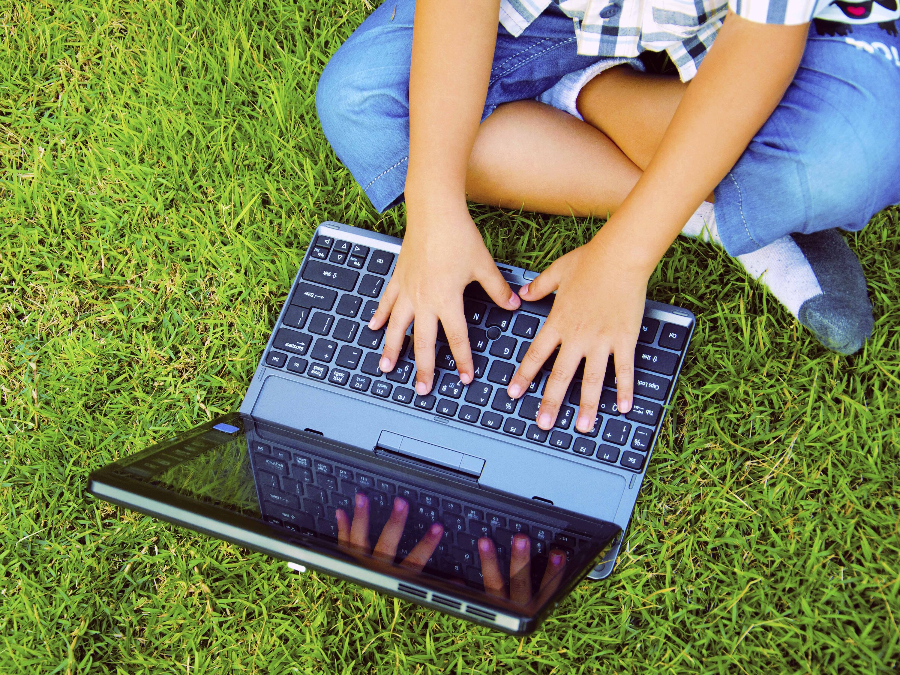 children laptop grass