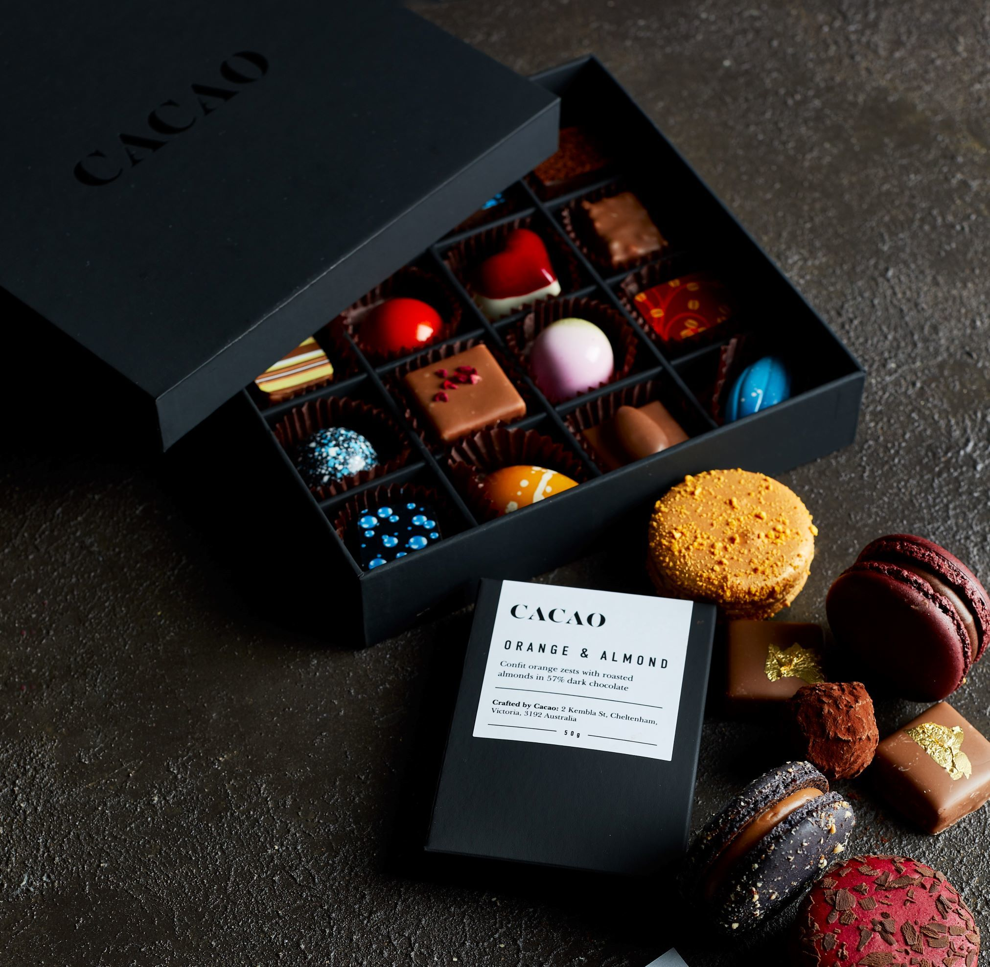 A box of mixed chocolates and macarons