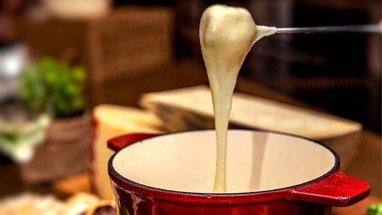 Fondue skewer dripping with cheese