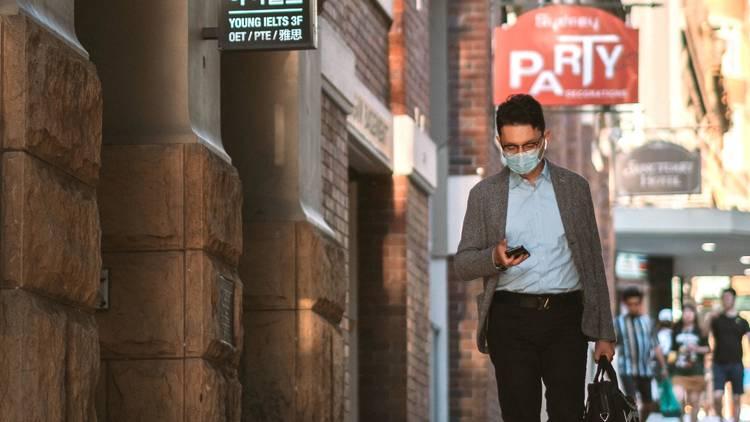 Man walking wearing face mask