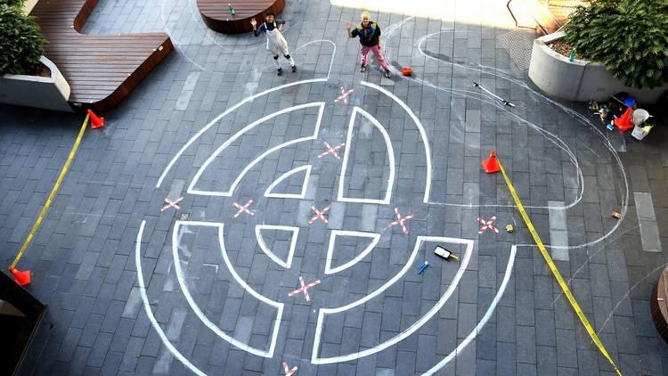 Nadia Odlum working on her maze mural 'I'll meet you here again'