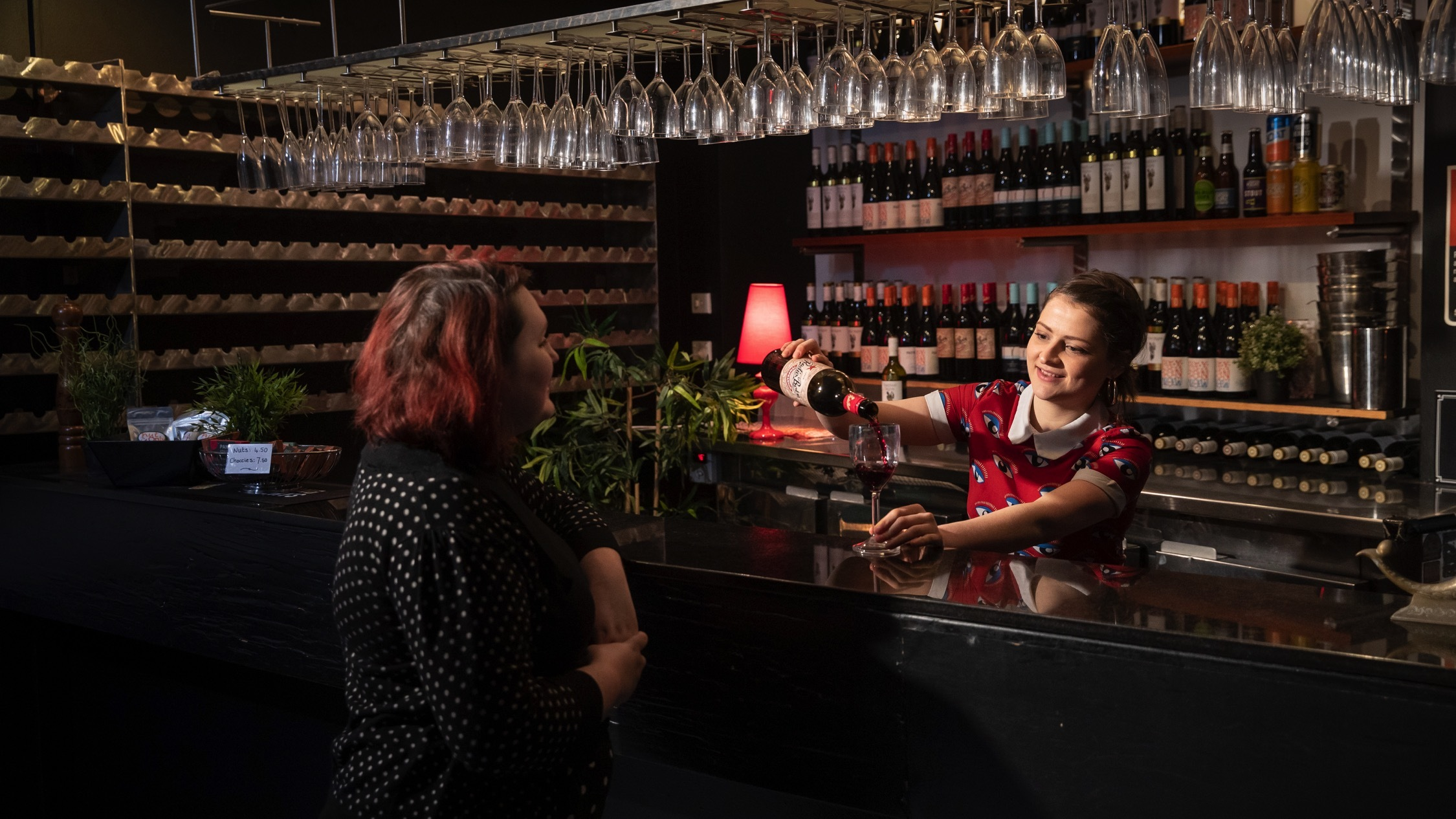Pouring drink at the bar at Giant Dwarf