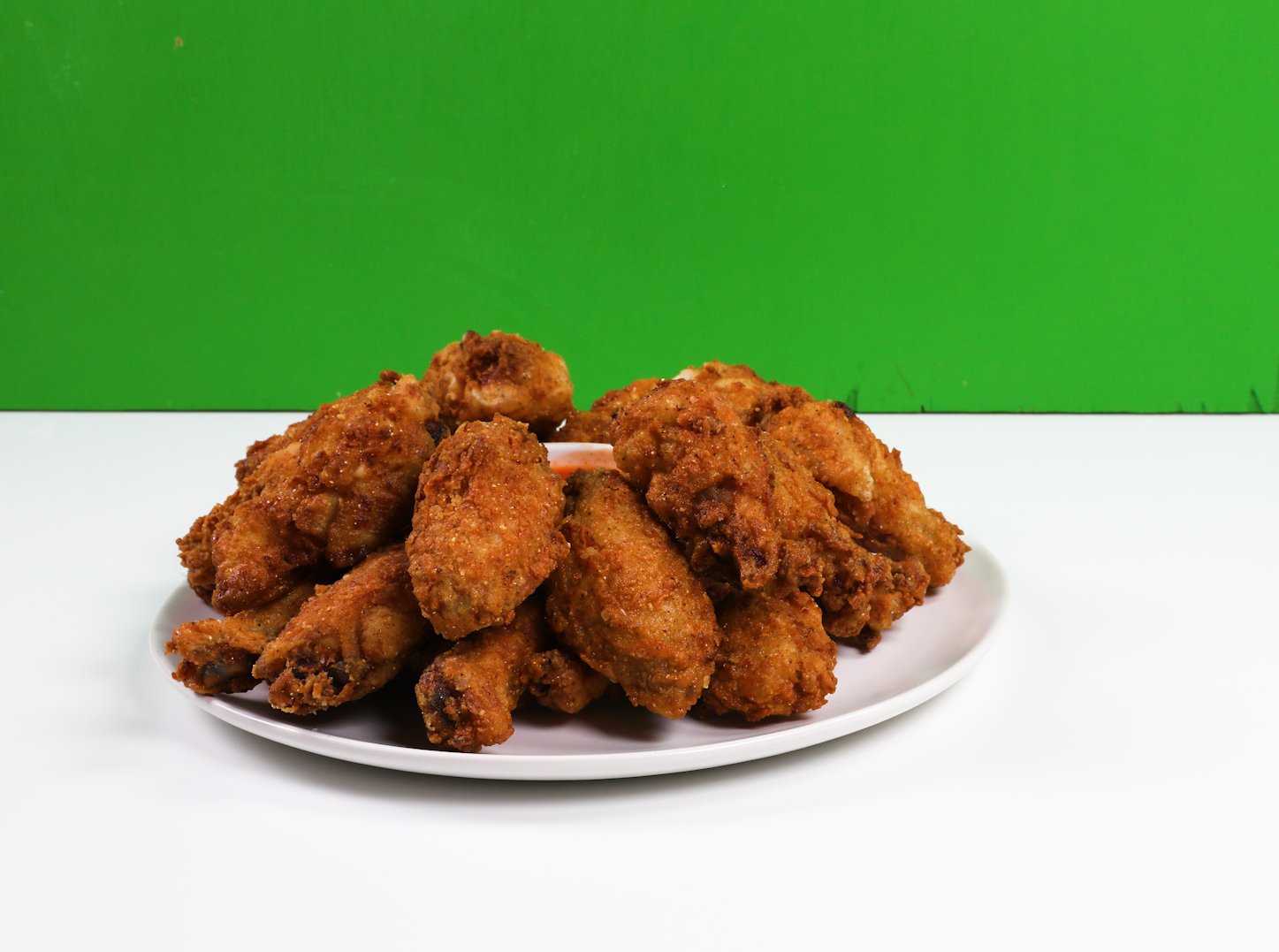 You can order wings created by Snoop Dogg and Shaq on National Wing Day