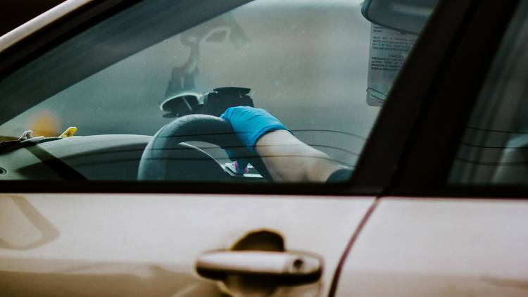 Driver wearing gloves at border crossing
