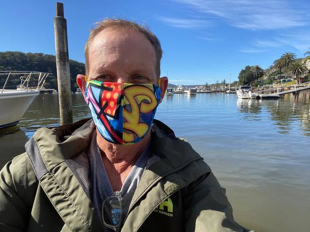 Todd McKenney taking a selfie while wearing a colourful face mask