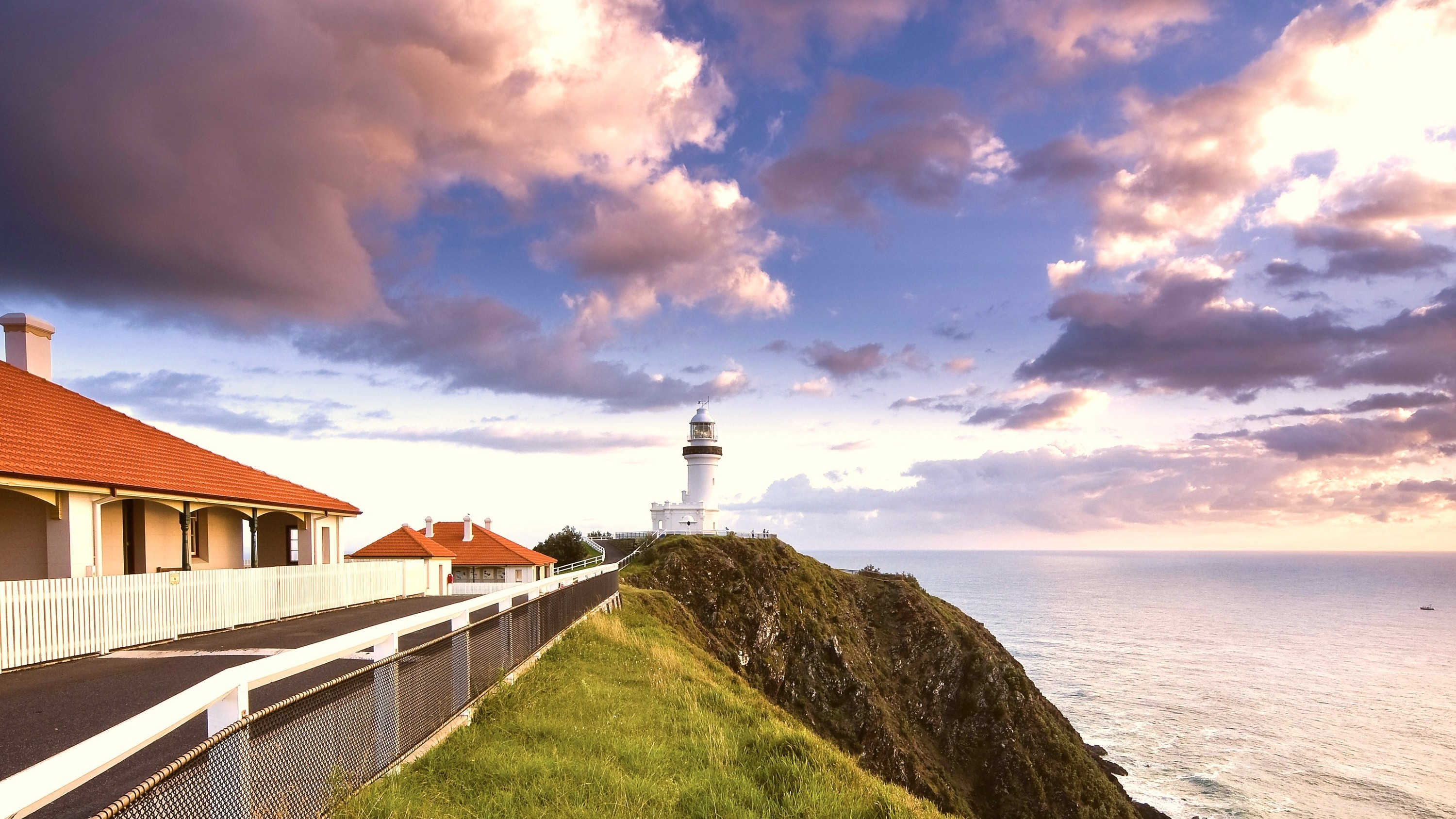 Cottage next to lighthouse by the sea