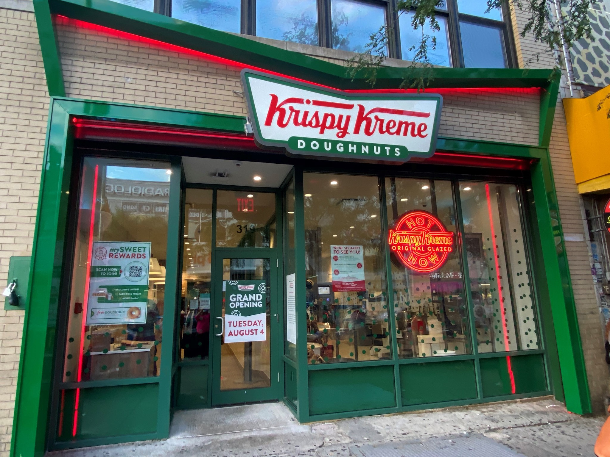 Krispy Kreme opens its first NYC shop with a Hot Light in Harlem today