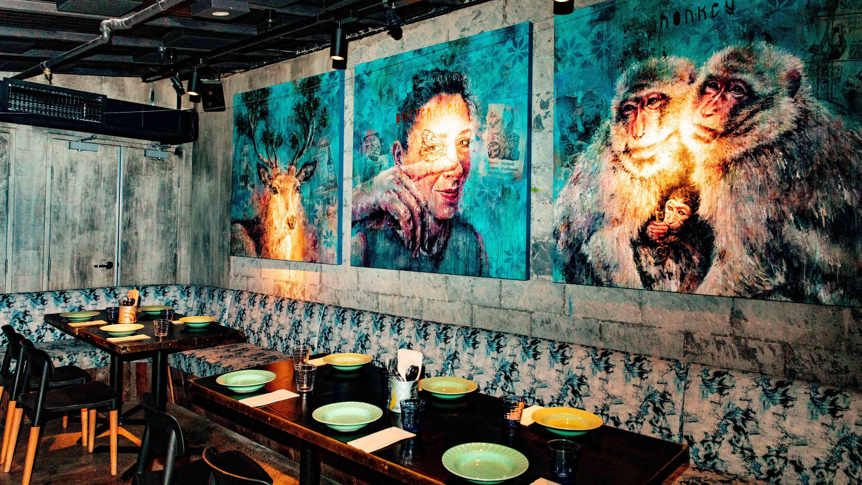 Tables in front of mural