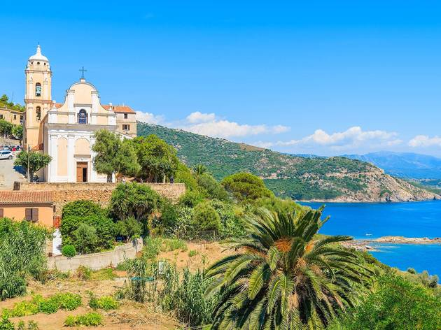 Typical church on coast of Corsica island in Cargese village, France