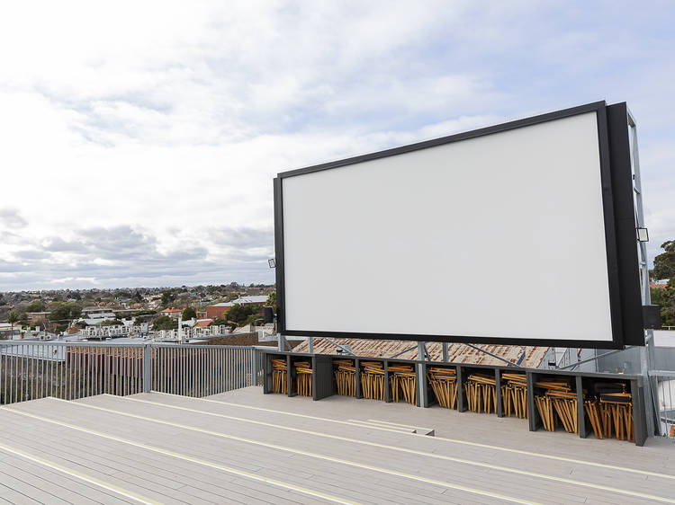 Have some drinks at Classic Rooftop Cinema