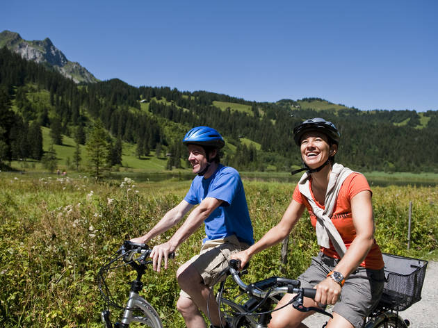 two people on e-bikes in the Swiss countryside
