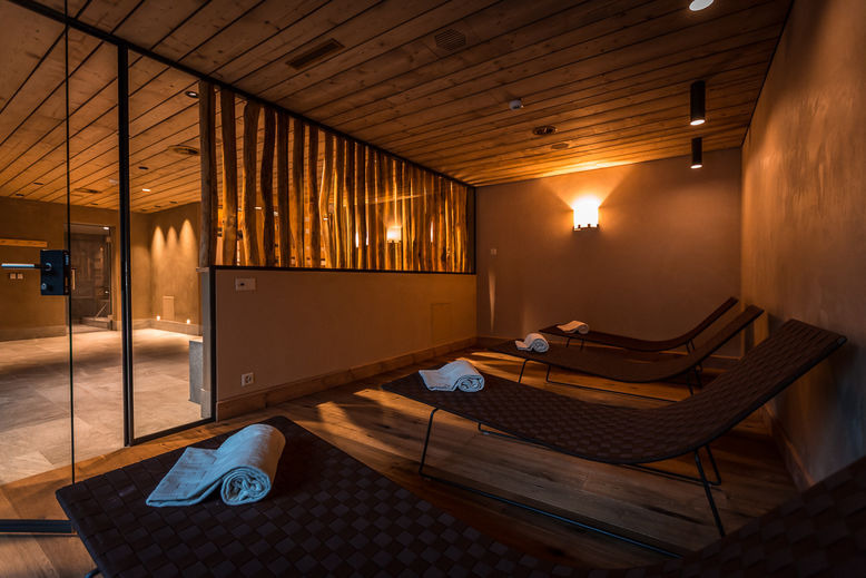 Inside a spa, with towels on treatment chairs.