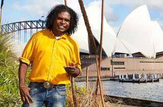 Indigenous tour guide Sharni in front of the Opera House