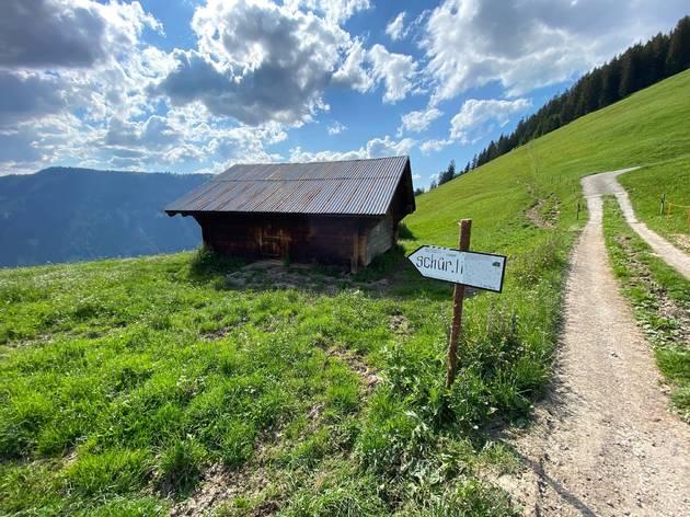 A wooden hut (Schürli) in the Swiss countryside.