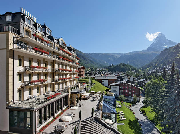 The facade of a grand hotel in the Swiss Alps.