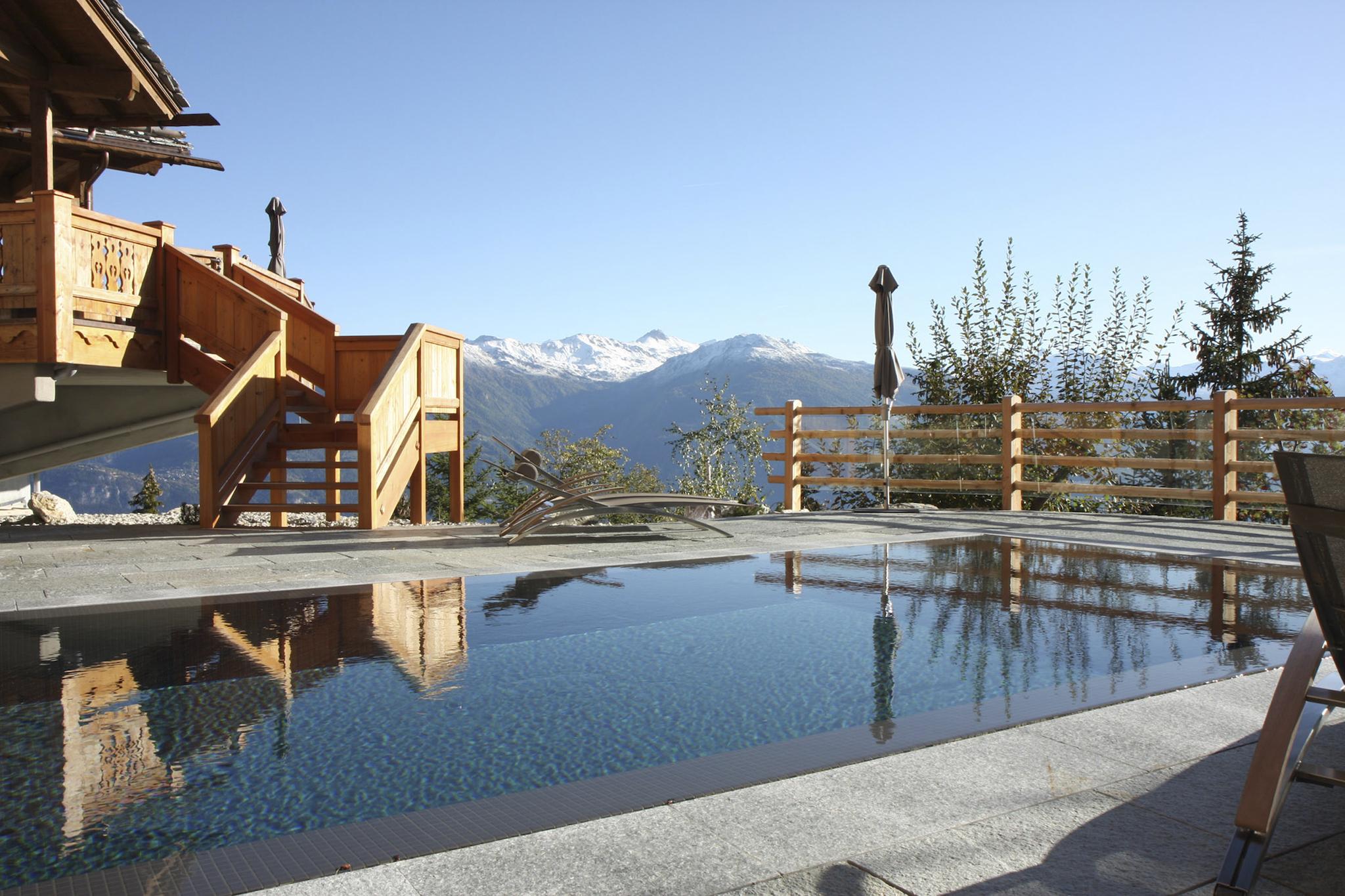 An outdoor pool at LeCrans Hotel, Switzerland.