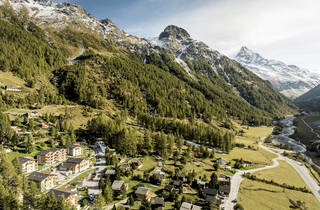 A hotel surrounded by Swiss mountains.
