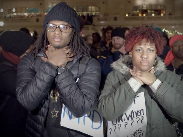 Two African-American protesters clutch their necks in Stephen Maing's powerful doco Crime + Punishment