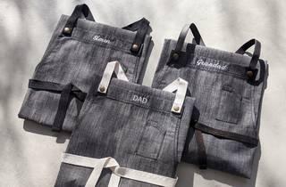 Three grey aprons
