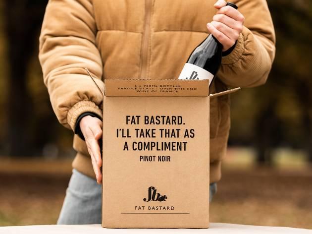 Man pulling wine from box