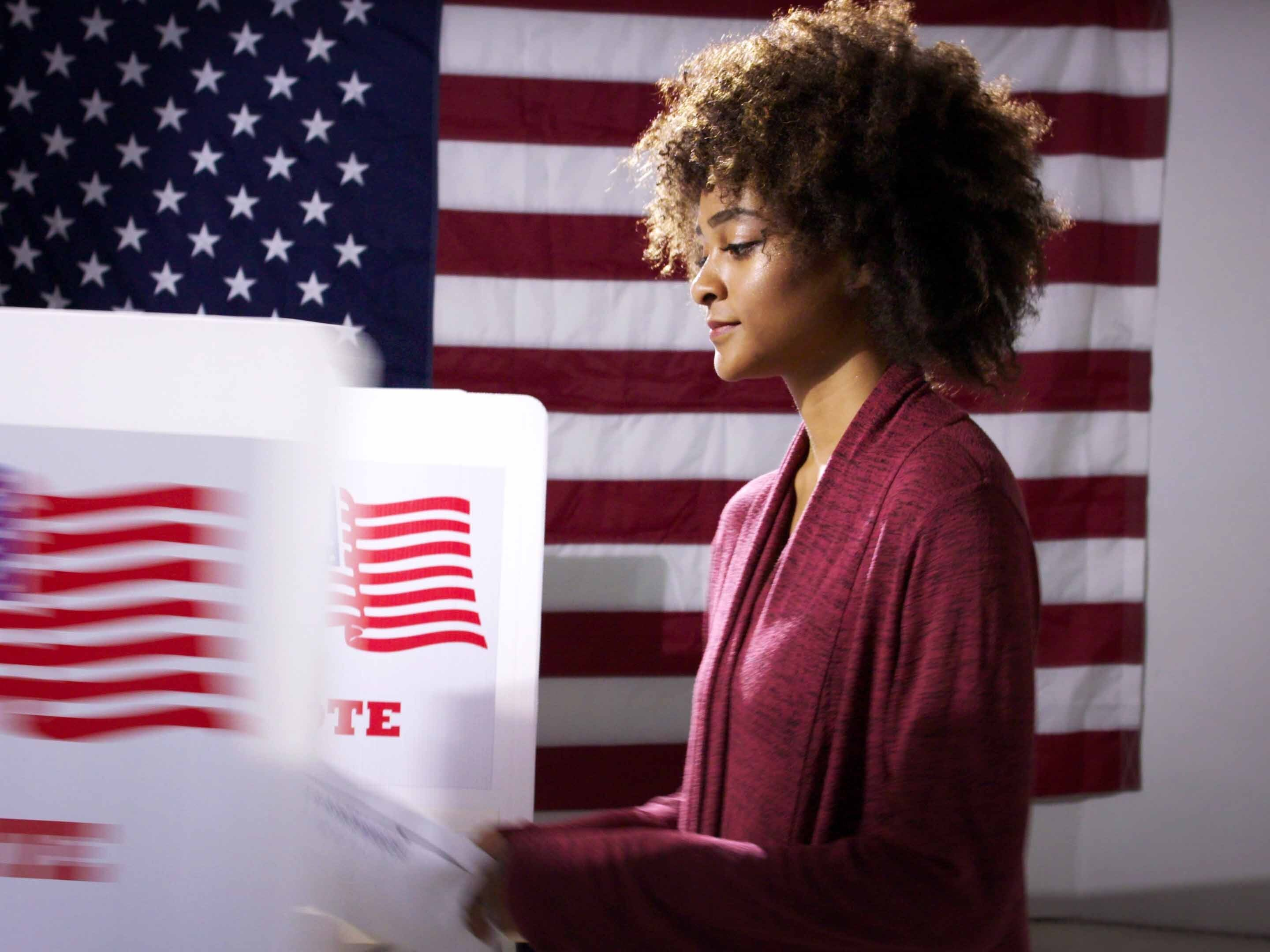 Woman voting at poll booth