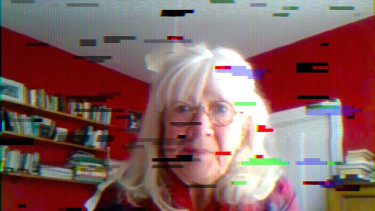 An older woman's face on webcam