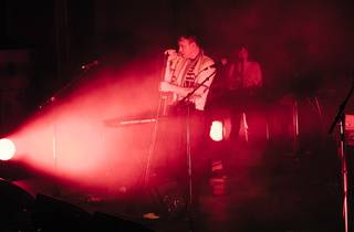 Total control Lead singer Daniel Stewart bathed in red light