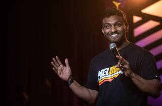 Nazeem Hussain performing on stage