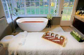 Treatment room with bath tub at Parklands Day Spa