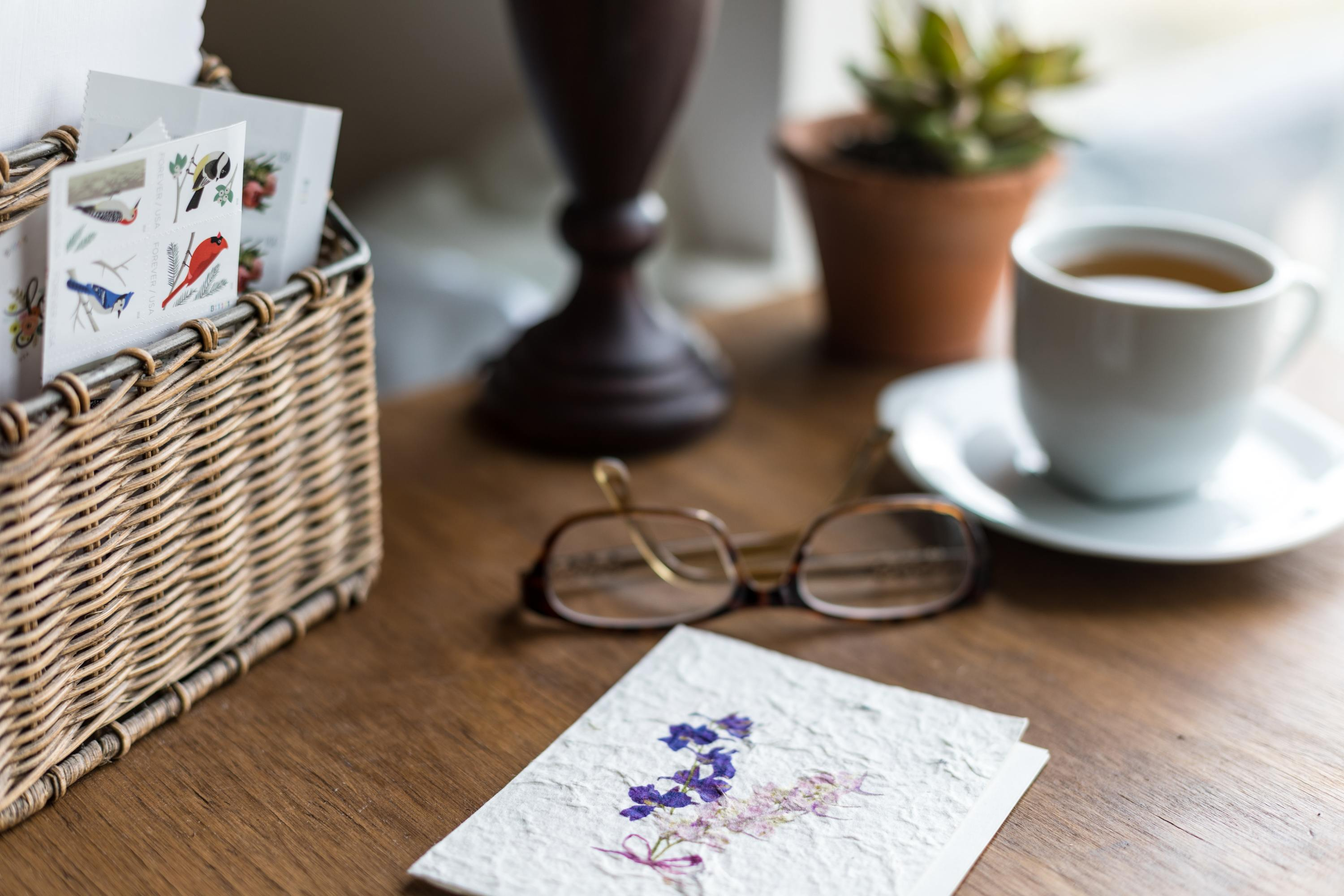 Letter on table next to glasses and mug
