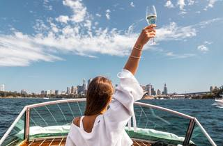 Speedboat on Sydney Harbour and a glass of Champagne