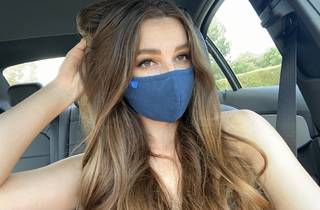 Person wearing a denim-coloured face mask