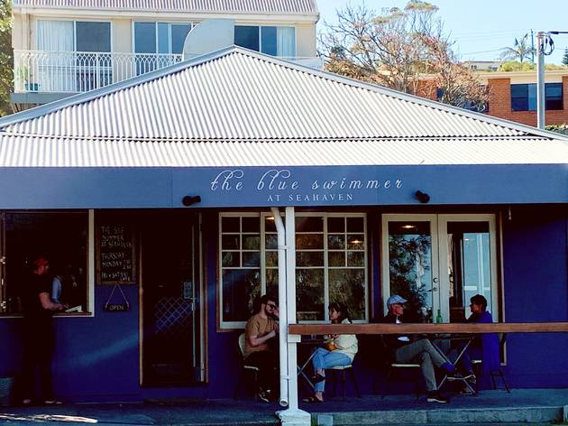 Facade of Blue Swimmer cafe with chairs outside