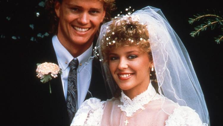 Kylei Minogue and Jason Donovan as Charlene and Scott on their wedding day in Neighbours