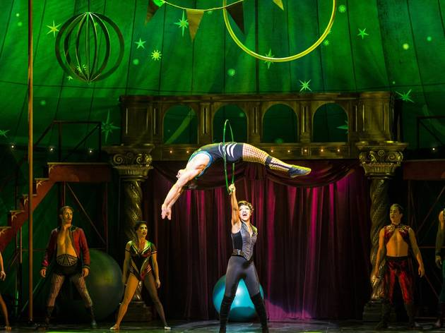 A green hued circus tent cast photo from the Us tour of Pippin