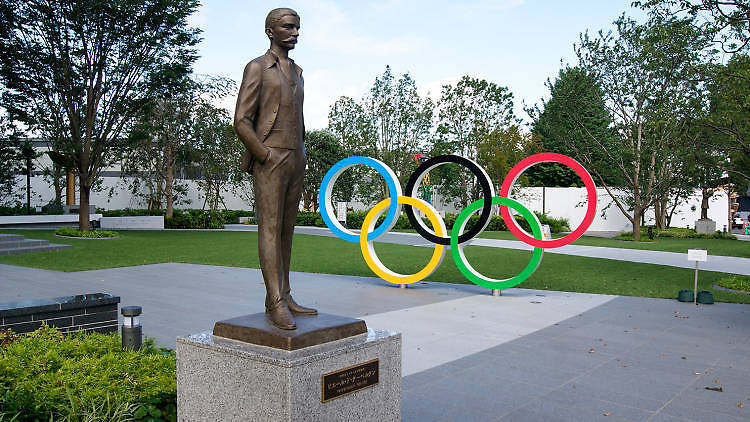 Photo: Joel Papalini/Dreamstime Olympic rings and statue of Pierre de Coubertin near the new national stadium in Tokyo