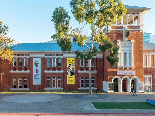 Exterior shot of red brick heritage-listed building housing the Perth Institute of Contemporary Arts
