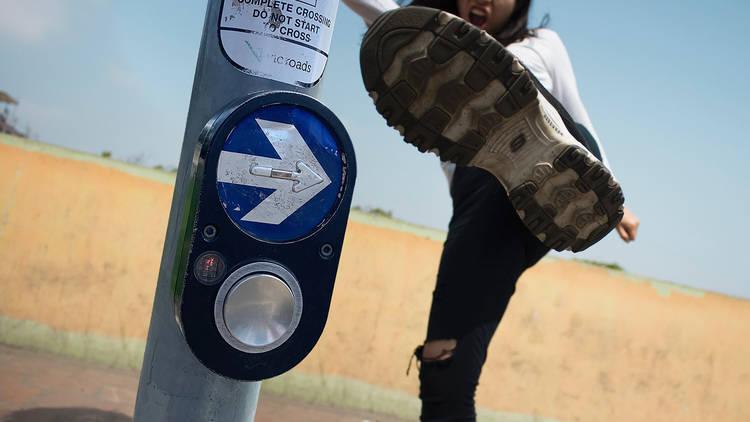 Kicking crosswalk button