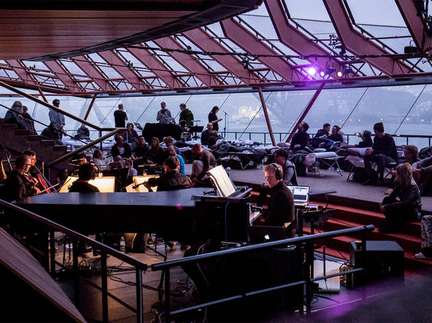 Max Richter plays 'Sleep' on the piano at the Opera House while listeners doze on camp beds surrounding him