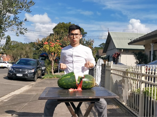 Person chopping watermelon in half for J-Talent quest