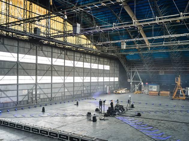 London Topaz performing in a cavernous airplane hangar