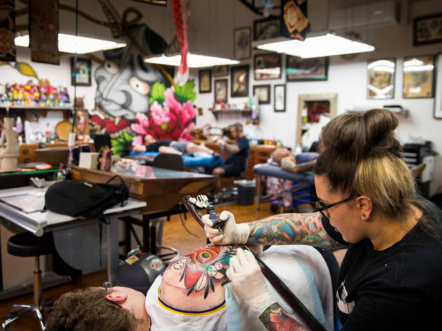 Artists at work at Lighthouse Tattoo