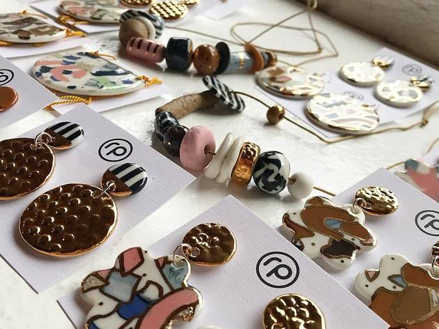 Flat lay of Ruby Piven ceramic earrings and necklaces