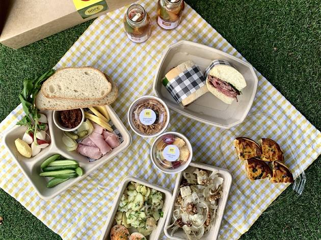 Picnic featuring ploughman's lunch, salads, sandwiches.