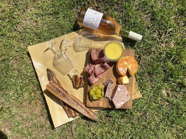 Picnic featuring wine, baguette and charcuterie.