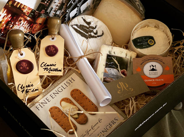 Picnic hamper featuring martinis, cheeses and wheat fingers.