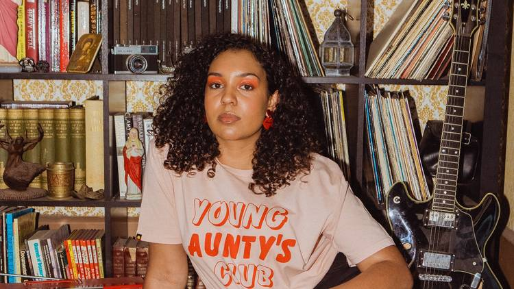 Woman wearing a tshirt that says 'Young Aunty's Club'